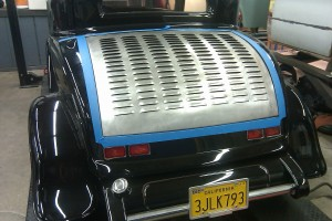 We fit a steel truck lid with louvers to a 32 Ford fiberglass car.  We had to cut and narrow the steel lid to fit.