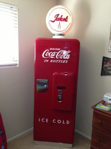 50's Coca-Cola machine converted to bookcase. Lettering on globe and outside by Tom Mcweeney.