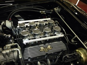 1955 T-bird we installed Hillborn Fuel Injected. Machined the valve covers to fit the emblems then ceramic coated them.
