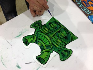 Panel Jammers Puzzle Piece painted by Kahrs.